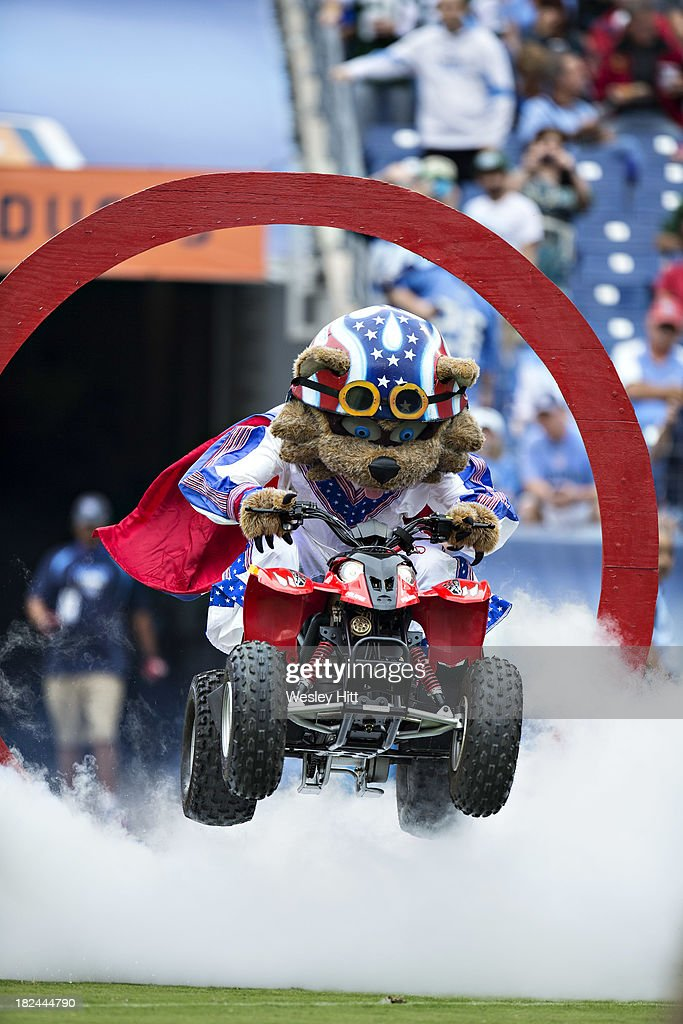 Mascot T-RAC of the Tennessee Titans jumps through a ring onto the field before a game against the New York Jets at LP Field on September 29, 2013 in Nashville, Tennessee. The Titans defeated the Jets 38-13.