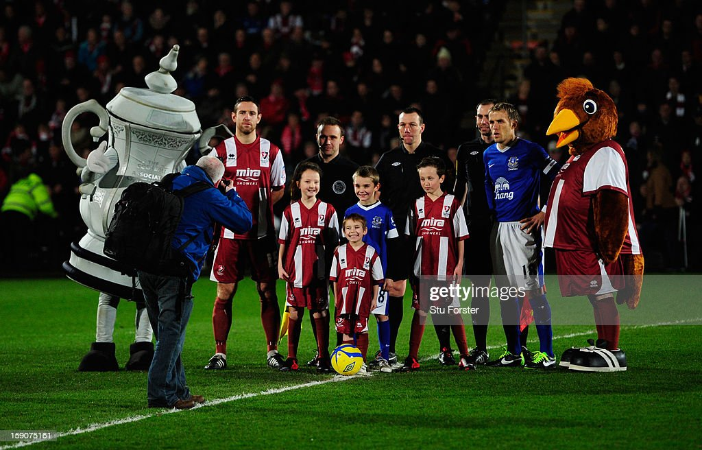 Mascots, captains and officials line up prior the FA Cup mascot prior to the FA Cup with Budweiser Third Round match between Cheltenham Town and Everton at Abbey Business Stadium on January 7, 2013 in Cheltenham, England.