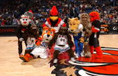 Mascots from around the NBA and other professional leagues pose after playing musical chairs during halftime of a game between the Memphis Grizzlies...