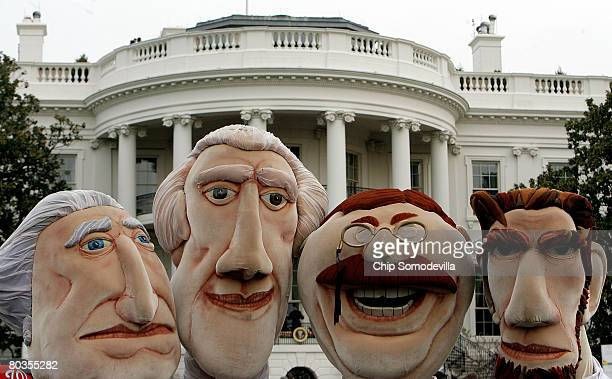 Mascots from the Washington Nationals baseball team pose for photographs during the annual Easter Egg Roll on the South Lawn of the White House March...