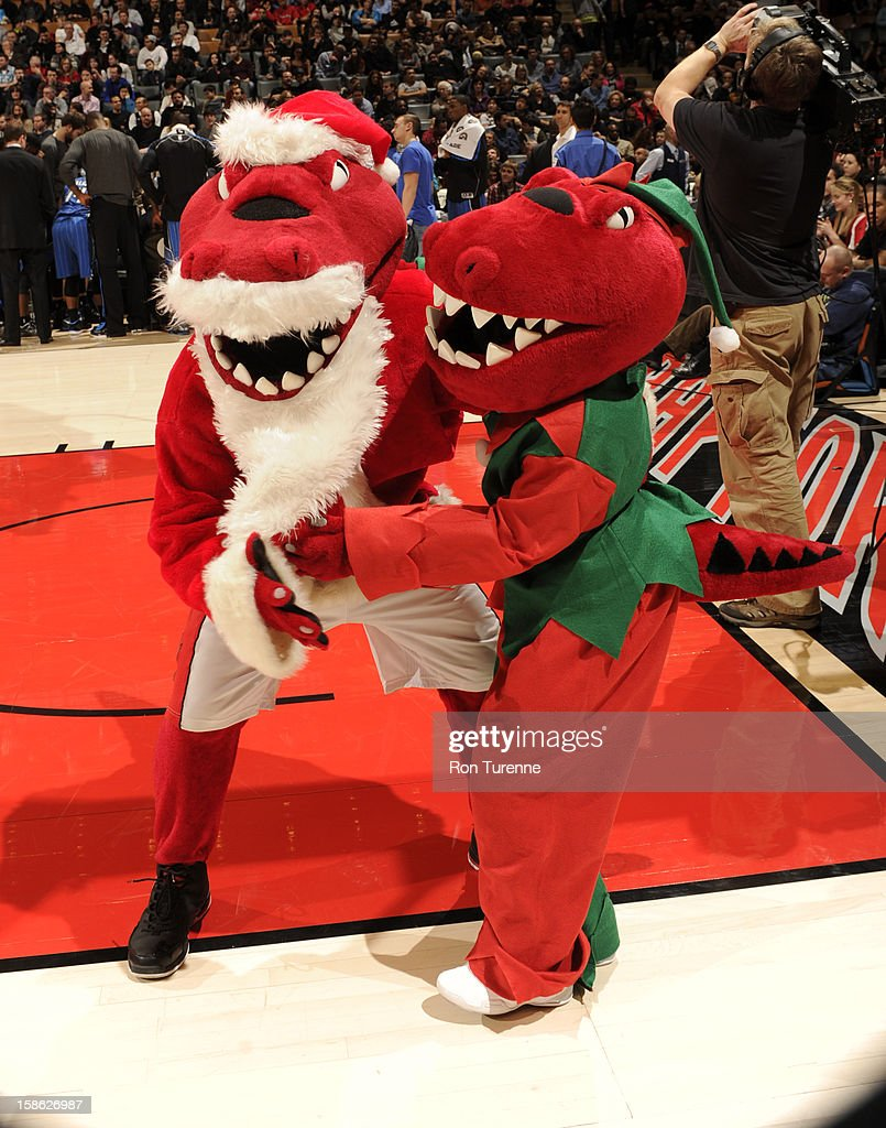 Mascots of the Toronto Raptors hangout during a timeout against the Orlando Magic during the game on December 19, 2012 at the Air Canada Centre in Toronto, Ontario, Canada.