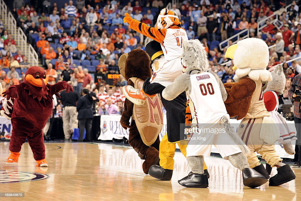 ACC mascots play a pick-up game during halftime of a game between the North Carolina State Wolfpack and the Virginia Cavaliers during the quarterfinals of the 2013 Men's ACC Tournament at the Greensboro Coliseum on March 15, 2013 in Greensboro, North Carolina.