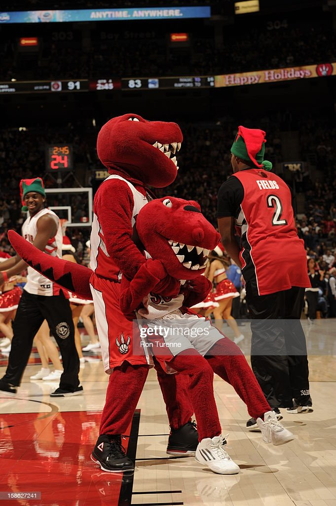 Mascots play around during a timeout against the Orlando Magic during the game on December 19, 2012 at the Air Canada Centre in Toronto, Ontario, Canada.
