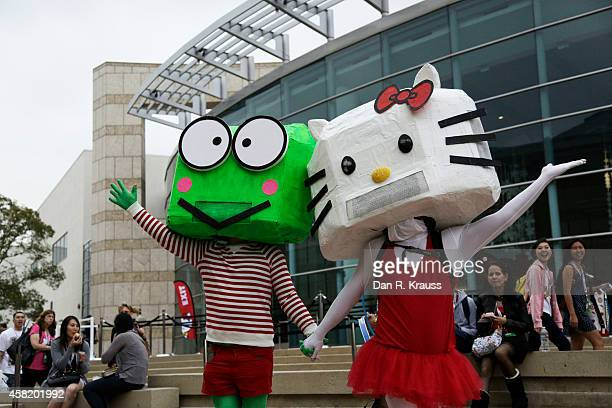 Mascots pose outside of Hello Kitty Con October 31 2014 at The Geffen Contemporary at MOCA in Los Angeles California Some 25000 fans are expected to...
