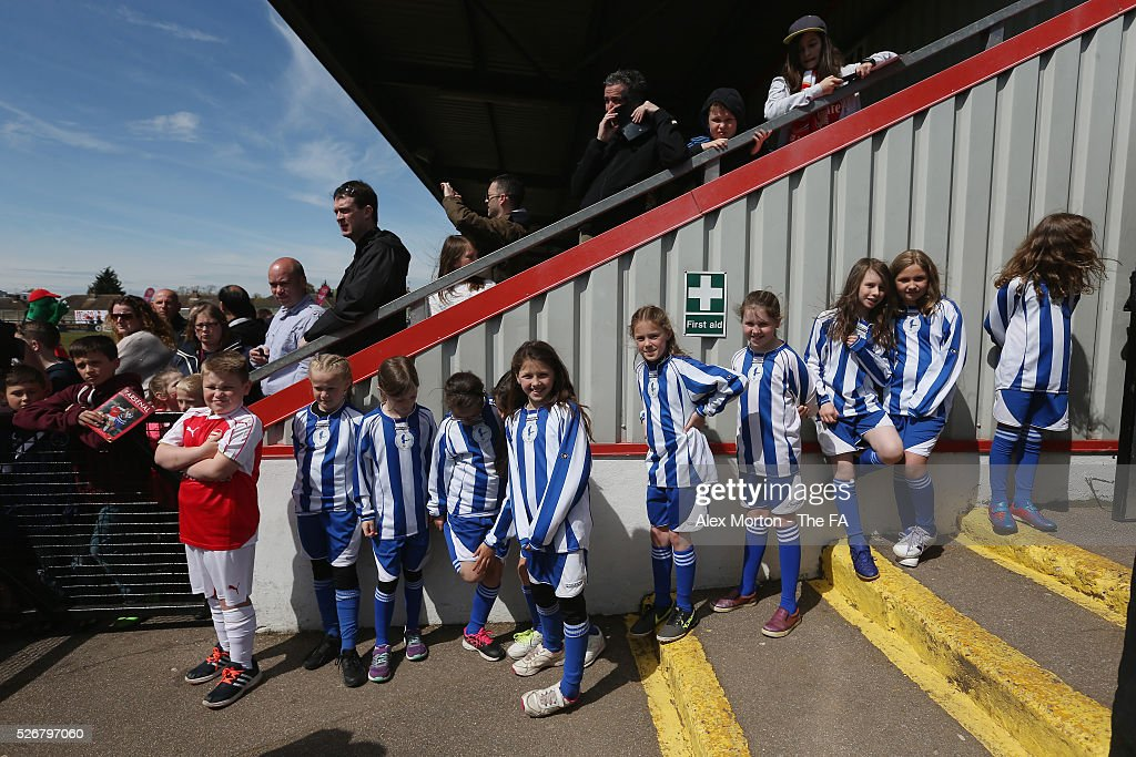 Mascots wait to meet the players prior to the WSL match between Arsenal Ladies and Birmingham City Ladies at Meadow Park on May 1, 2016 in Borehamwood, England.