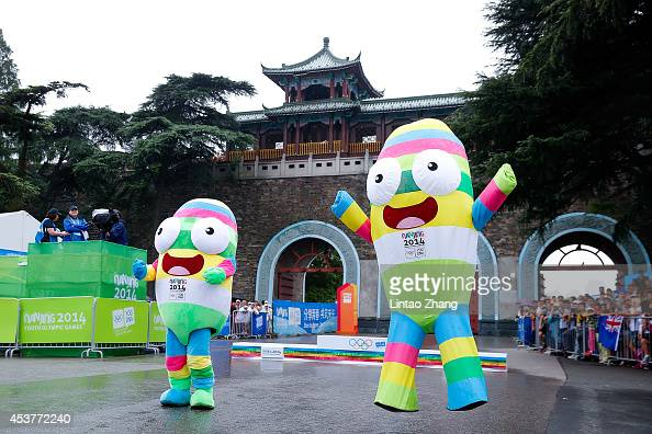 Mascots wave dancing before the medal ceremony for the Men's Triathlon on day two of Nanjing 2014 Summer Youth Olympic Games at Xuanwu Lake Triathlon...