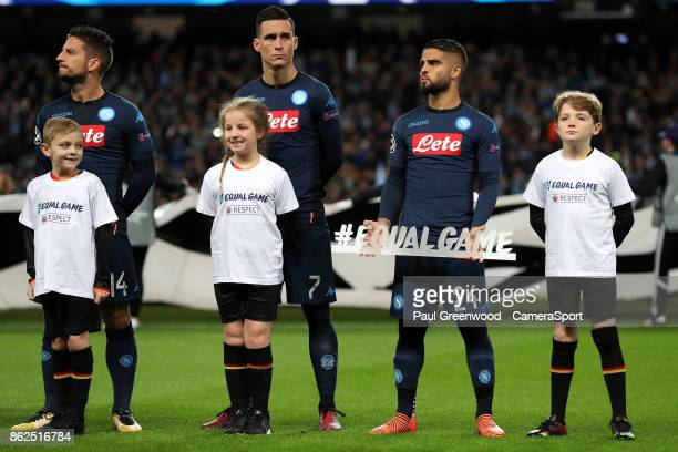 Mascots wear T Shirts with the slogan #equalfgame on them as Napoli's Lorenzo Insigne holds a signs saying #equalgame as the team line up ahead of...