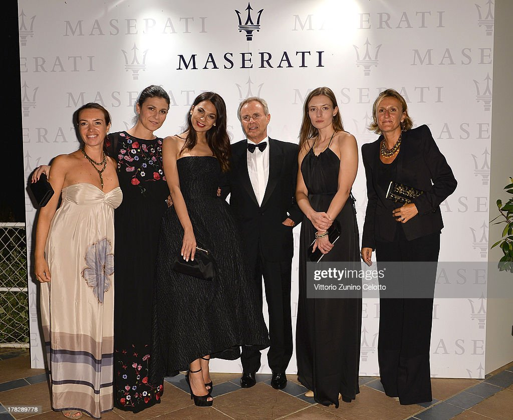 Maserati CEO Harald J. Wester attends (C) and actress <a gi-track='captionPersonalityLinkClicked' href=/galleries/search?phrase=Moran+Atias&family=editorial&specificpeople=3964520 ng-click='$event.stopPropagation()'>Moran Atias</a> (3rd L) during the 70th Venice International Film Festival at Terrazza Maserati on August 28, 2013 in Venice, Italy.