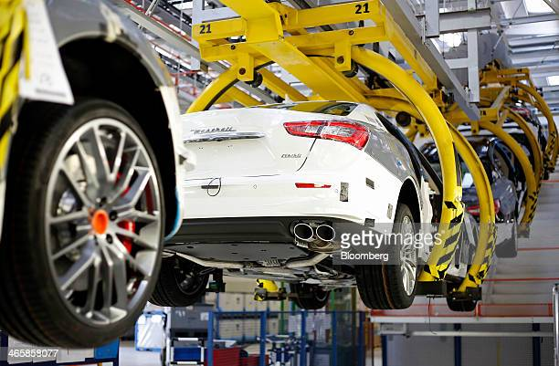 Maserati Ghibli luxury automobiles produced by Maserati SpA travel along the production line at Fiat SpA's Grugliasco factory in Turin Italy on...