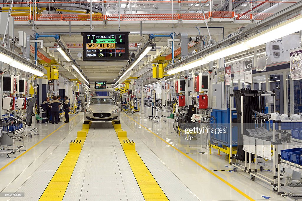 A Maserati luxury car is displayed on the assembly line during the opening of a new plant for the company's luxury brand Maserati on January 30, 2013 in Grugliasco. Italian auto giant Fiat's bosses said they had made 'difficult choices' to continue producing in Italy despite a fall in sales but would not be shutting any plants as feared earlier. AFP PHOTO / FILIPPO ALFERO