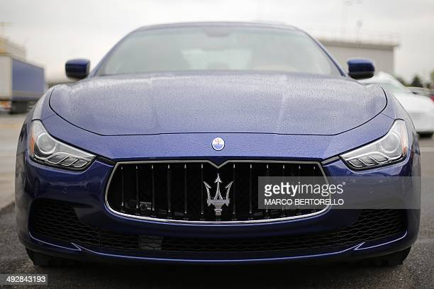 A Maserati Quattroporte is parked outside a Maserati plant on May 22 2014 in Grugliasco near Turin The plant was renamed after late Italian President...