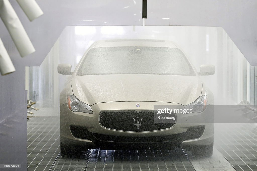 A Maserati Quattroporte luxury automobile undergoes a water test during production at Fiat SpA's Grugliasco factory in Turin, Italy, on Wednesday, Jan. 30, 2013. Fiat SpA Chief Executive Officer Sergio Marchionne said the Italian carmaker narrowed losses in Europe in the fourth quarter, helping it achieve full-year earnings that were in line with its forecasts. Photographer: Alessia Pierdomenico/Bloomberg via Getty Images