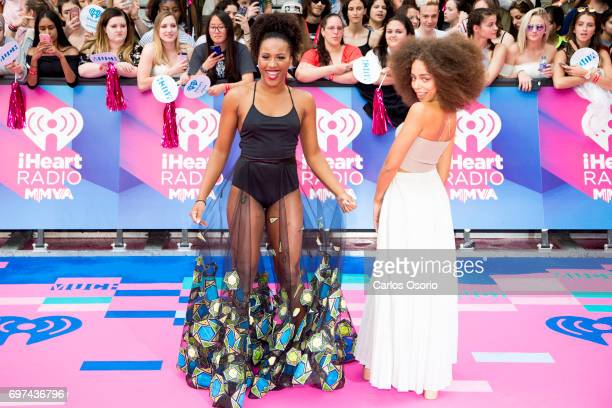 TORONTO ON JUNE 18 Masha Bromfield and and Hayley Law of Riverdale walk the carpet at the 2017 iHeartRadio Much Music Video Awards in Toronto on June...