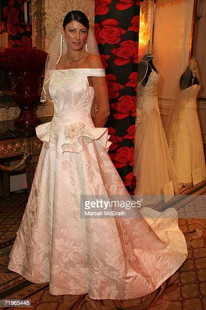 Masha Chase poses wearing an Oscar De La Renta gown at the first annual Los Angeles wedding salon where wedding planners share ideas at the Four...