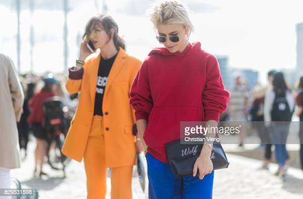 Masha Sedgwick wearing a yellow Lala Berlin suit Givenchy clutch and tshirt YSL shoes and Caroline Daur wearing a red hoody outside Designers Remix...