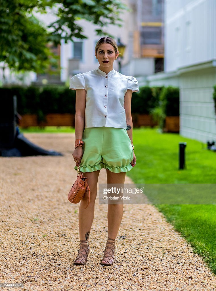Masha Sedgwick wearing white blouse and green shorts outside Marina Hoermanseder during the Mercedes-Benz Fashion Week Berlin Spring/Summer 2017 on June 30, 2016 in Berlin, Germany.