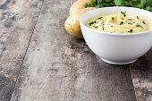 Mashed potato on wooden background