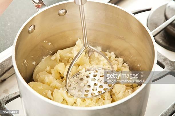 Mashing Potatoes in a Pot
