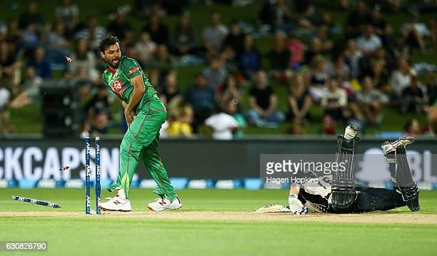 Mashrafe Mortaza of Bangladesh celebrates as he runs out Tom Bruce of New Zealand during the first Twenty20 match between New Zealand and Bangladesh...
