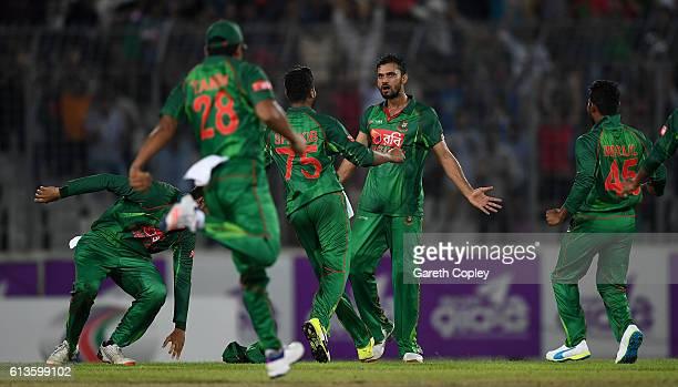 Mashrafe Mortaza of Bangladesh celebrates Ben Stokes of England during the 2nd One Day International match between Bangladesh and England at...