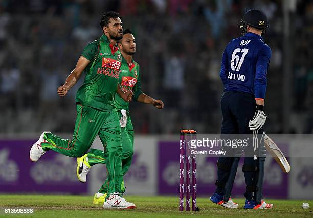 Mashrafe Mortaza of Bangladesh celebrates Jason Roy of England during the 2nd One Day International match between Bangladesh and England at...
