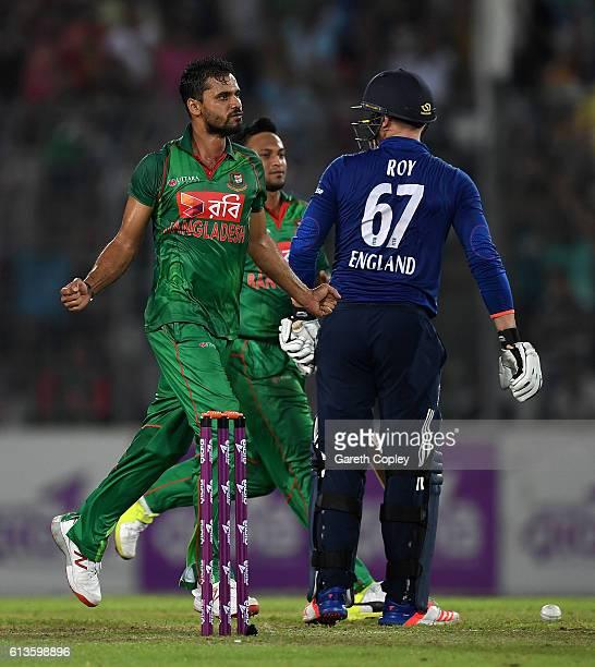 Mashrafe Mortaza of Bangladesh celebrates Jason Roy of England during the 2nd One Day International match between Bangladesh and England at...