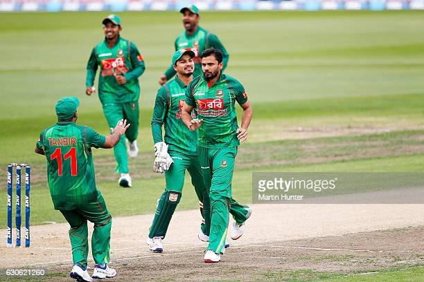Mashrafe Mortaza of Bangladesh celebrates the wicket of Martin Guptill of New Zealand during the second One Day International match between New...