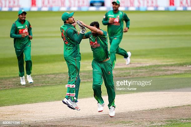Mashrafe Mortaza of Bangladesh celebrates the wicket of Martin Guptill of New Zealand during the second One Day International match between New...