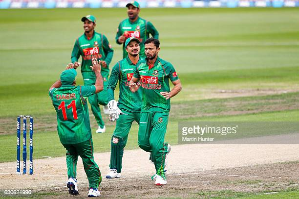 Mashrafe Mortaza of Bangladesh celebrates with team mates after the wicket of Martin Guptill of New Zealand during the second One Day International...