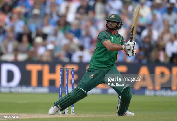 Mashrafe Mortaza of Bangladesh hits a four during the ICC Champions Trophy match between Bangladesh and India at Edgbaston cricket ground on June 15...