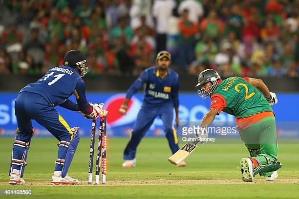 Mashrafe Mortaza of Bangladesh is stumpby Kumar Sangakkara of Sri Lanka during the 2015 ICC Cricket World Cup match between Sri Lanka and Bangladesh...