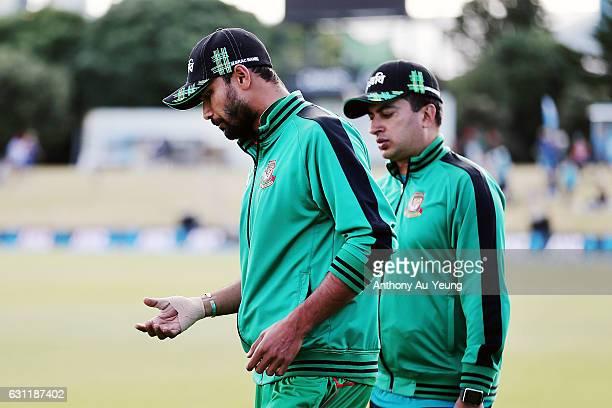 Mashrafe Mortaza of Bangladesh looks to rest his injured right hand after the third Twenty20 International match between New Zealand and Bangladesh...