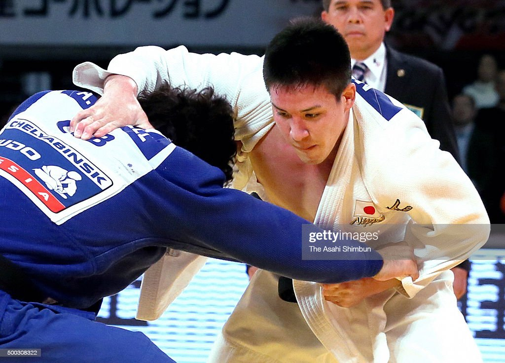 Mashu Baker (white) of Japan and Asley Gonzalez (blue) of Cuba compete in the Men's -90kg final during day three of the Judo Grand Slam at Tokyo Metropolitan Gymnasium on December 6, 2015 in Tokyo, Japan.