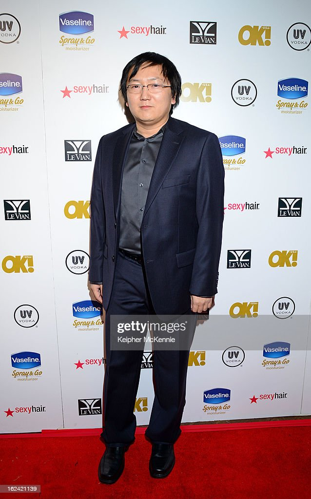 <a gi-track='captionPersonalityLinkClicked' href=/galleries/search?phrase=Masi+Oka&family=editorial&specificpeople=744993 ng-click='$event.stopPropagation()'>Masi Oka</a> steps on the red carpet at OK! Magazine Pre-Oscar Party at The Emerson Theatre on February 22, 2013 in Hollywood, California.