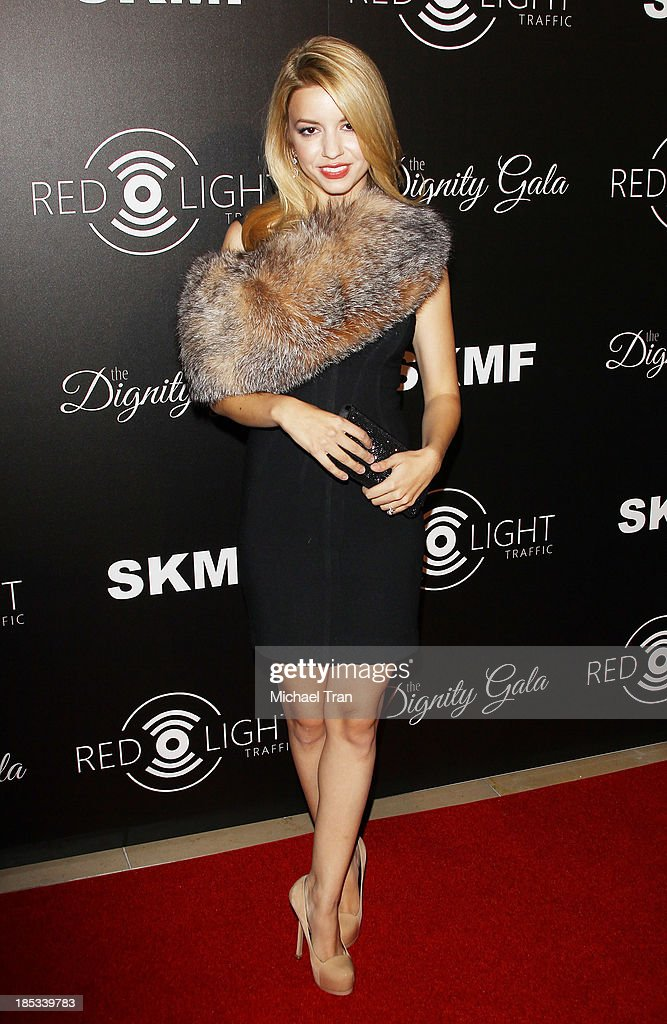 <a gi-track='captionPersonalityLinkClicked' href=/galleries/search?phrase=Masiela+Lusha&family=editorial&specificpeople=213392 ng-click='$event.stopPropagation()'>Masiela Lusha</a> arrives at the launch of the Redlight Traffic APP - Dignity Gala held at The Beverly Hilton Hotel on October 18, 2013 in Beverly Hills, California.