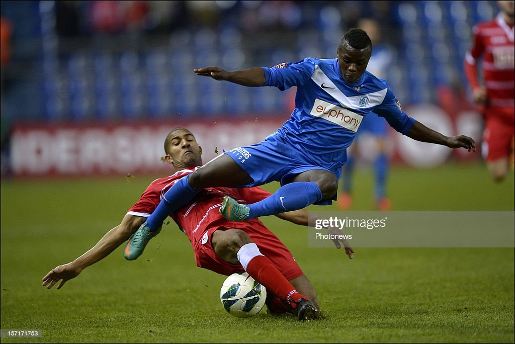 Masika Ayub of KRC Genk is tackled by William Vainqueur of Standard during the Cofidis Cup 1/8 final match between KRC Genk and Standard Liege on November 29, 2012 in Genk , Belgium.