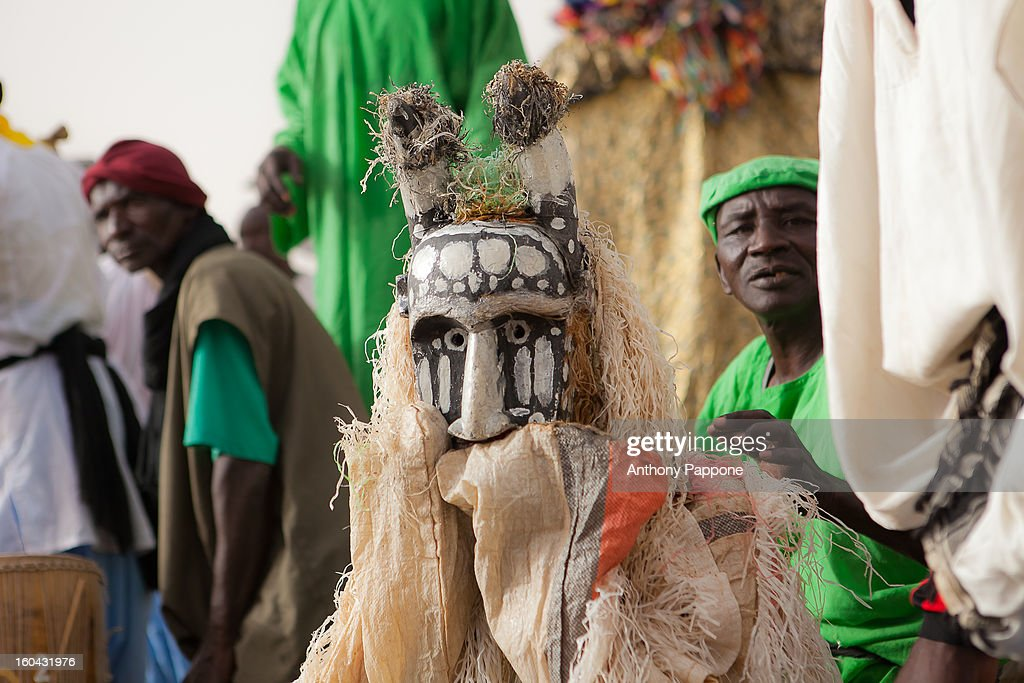 CONTENT] mask comes with a boat from the river niger during Festival on the Niger in Segou, sahel, mali