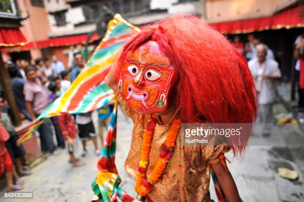 A mask dancer 'Lakhay' dancing in the traditional ritual tunes of drums n the fourth day of Indra Jatra Festival celebrated at Basantapur Durbar...