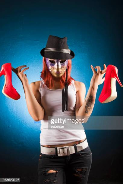 Mask girl holding her shoes