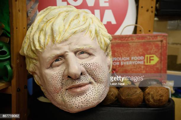 A mask of Foreign Secretary Boris Johnson is seen among other props in the store room at Oxfam's headquarters on October 4 2017 in London England The...