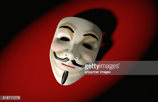 Mask of Guy Fawkes on red