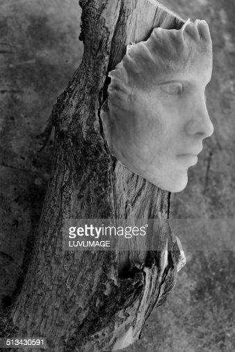 Mask on a treetrunk