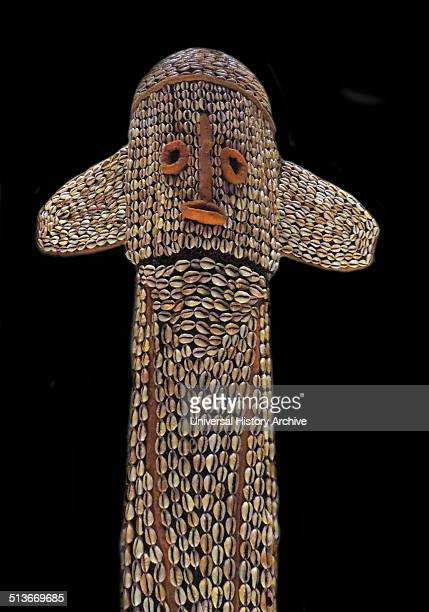 Mask Textile and cowrie shells Grasslands region of Cameroon 20th century This is an elephant mask performed by members of one of the powerful and...