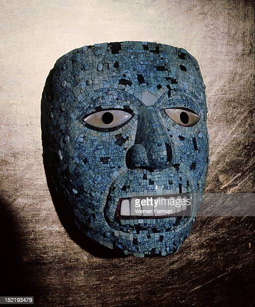 Mask usually thought to represent the god Quetzalcoatl although it could be a representation of Tonatiuh the sun god On the death of a king masks...