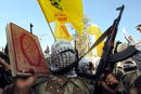A masked activist of Al Aqsa Martyrs' Brigade a militia linked to Palestinian leader Yasser Arafat's Fatah movement marches as he holds the Koran and...