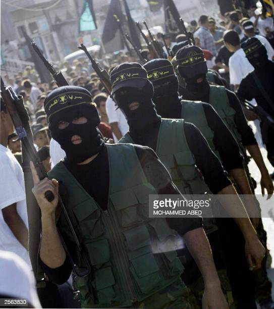 Masked and armed Palestinian militants of the radical Islamic Jihad group march during a rally at the Maghazi refugee camp in the central Gaza Strip...