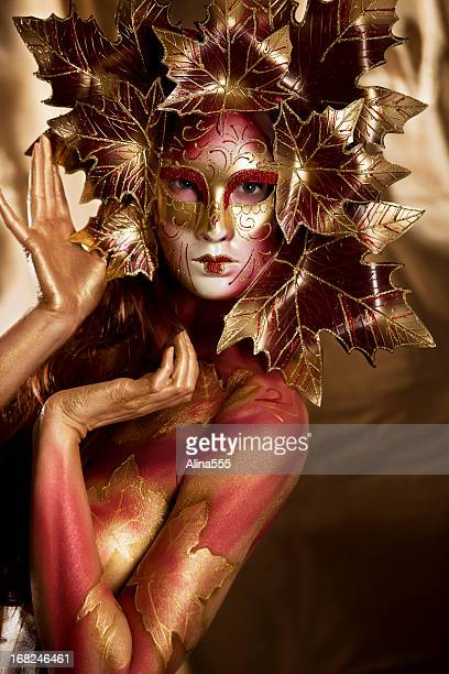 Masked Beauty: close-up portrait of woman with bodypainting