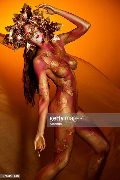 Masked Beauty: woman with bodypainting wearing a mask
