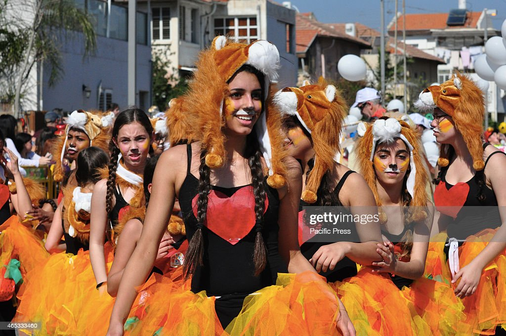 Masked children at the Adloyada in Holon the biggest Purim parade in Israel Adloyada is a humorous procession held in Israel in the Jewish holiday of...