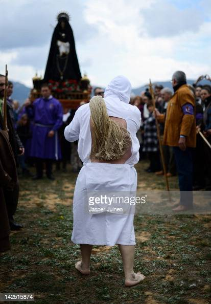 A masked flagellant lashes himself during the 'Los Picaos' Easter Week brotherhood procession on April 6 2012 in San Vicente de la Sonsierra Spain...